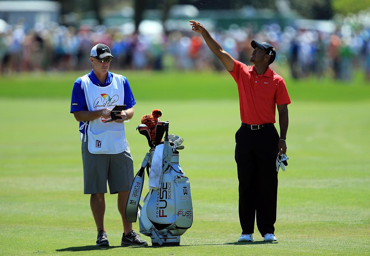 ORLANDO, FL - MARCH 25:  Tiger Woods of the USA waits to play his second shot at the par 4, first hole with his caddie Joe LaCava of the USA during the final round of the 2012 Arnold Palmer Invitational presented by MasterCard at Bay Hill Club and Lodge on March 25, 2012 in Orlando, Florida.  (Photo by David Cannon/Getty Images)