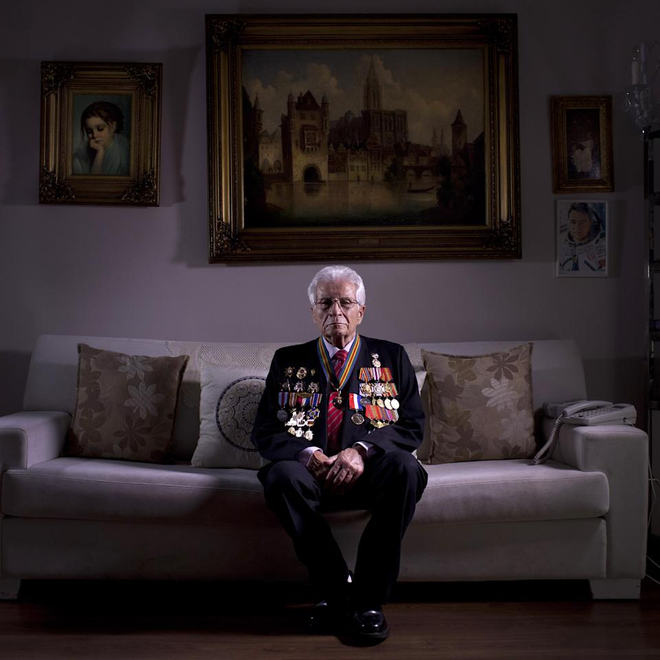 In this photo made Wednesday, April 10, 2013, Soviet Jewish World War Two veteran Shalom Skopes, 88, poses for a portrait at his house in Tel Aviv Israel. Skopes was a battalion commander in the Red Army, and fought in Latvia. During a battle he was injured by a hand grenade and was hospitalized until May 25, 1945, when Skopes demobilized in 1947 and immigrated to Israel in 1959. About 500,000 Soviet Jews served in the Red Army during World War Two, and the majority of those still alive today live in Israel. (AP Photo/Oded Balilty)