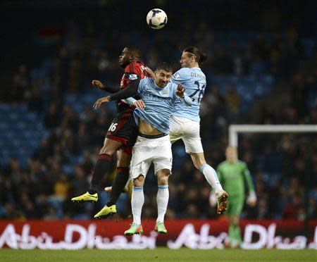 Manchester City's Demichelis and Kolarov challenge West Bromwich Albion's Anichebe during their English Premier League soccer match at the Etihad stadium in Manchester