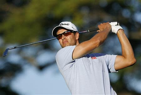 Adam Scott follows his ball after teeing off on the 11th hole during Sony Open golf tournament in Honolulu, Hawaii