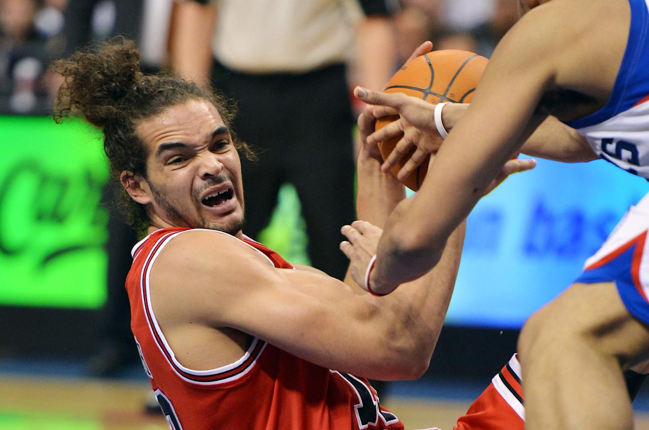 PHILADELPHIA, PA - MAY 04: Joakim Noah #13 of the Chicago Bulls looks to pass the ball during the game against the Philadelphia 76ers in Game Three of the Eastern Conference Quarterfinals in the 2012 NBA Playoffs at the Wells Fargo Center on May 4, 2012 in Philadelphia, Pennsylvania. NOTE TO USER: User expressly acknowledges and agrees that, by downloading and or using this photograph, User is consenting to the terms and conditions of the Getty Images License Agreement. (Photo by Drew Hallowell/Getty Images)