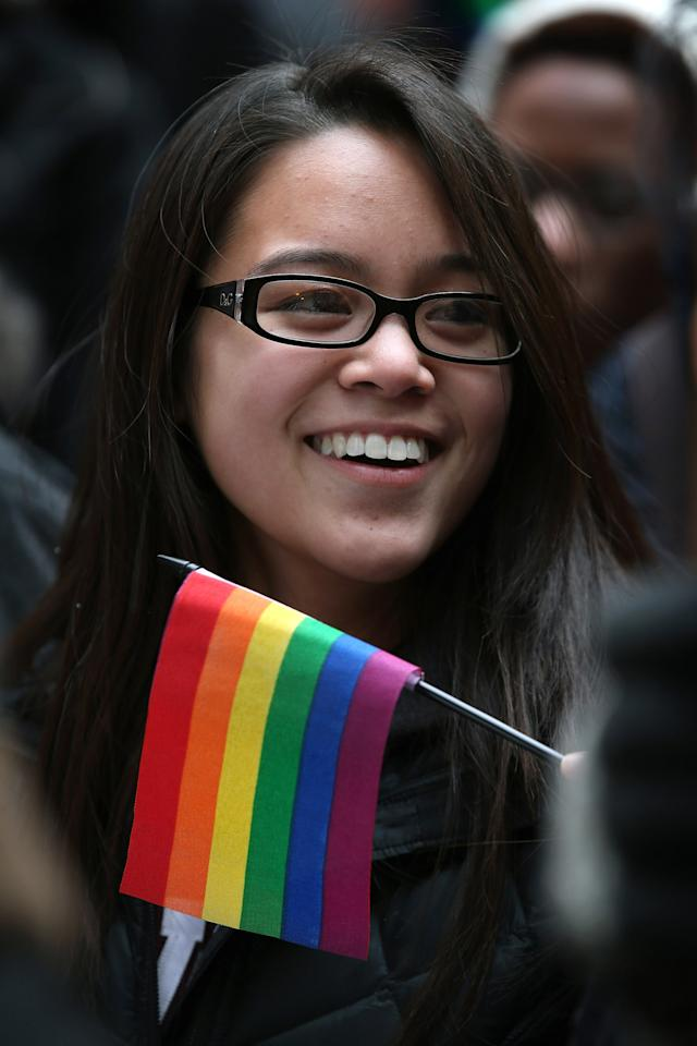 CHICAGO, IL - MARCH 25:  Joi Abarintos participates in a rally in support of gay marriage March 25, 2013 in Chicago, Illinois. The Supreme Court will hear arguments this week in two cases that could determine if states or the federal government can treat same-sex couples and those of the opposite sex differently when recognizing a marriage. The Illinois Senate has approved legislation that will legalize same-sex marriage in the state but it still has to be approved by the Illinois House and signed by Governor Pat Quinn, who has said he supports the legislation. If passed Illinois would become the tenth state to allow same-sex marriage. Thirty states have defined marriage as a union between a man and a woman.  (Photo by Scott Olson/Getty Images)