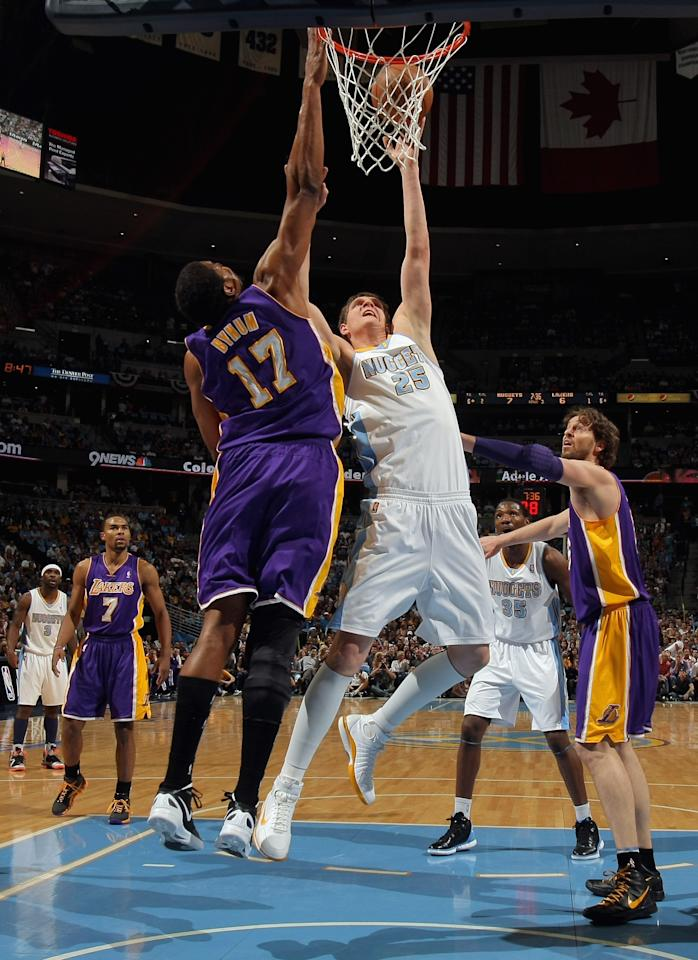 DENVER, CO - MAY 04:  Andrew Bynum #17 of the Los Angeles Lakers blocks a shot by Timofey Mozgov #25 of the Denver Nuggets in Game Three of the Western Conference Quarterfinals in the 2012 NBA Playoffs at Pepsi Center on May 4, 2012 in Denver, Colorado. NOTE TO USER: User expressly acknowledges and agrees that, by downloading and or using this photograph, User is consenting to the terms and conditions of the Getty Images License Agreement.  (Photo by Doug Pensinger/Getty Images)