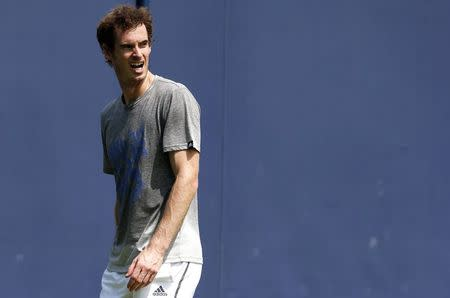 Britain's Andy Murray reacts during a practice session at the Queen's Club Championships in west London
