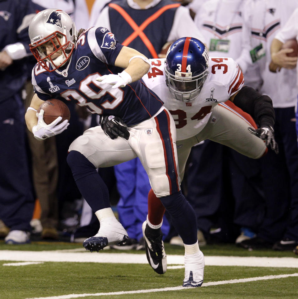 New England Patriots running back Danny Woodhead (39) is tackled by New York Giants safety Deon Grant (34) during the second half of the NFL Super Bowl XLVI football game, Sunday, Feb. 5, 2012, in Indianapolis. (AP Photo/David J. Phillip)