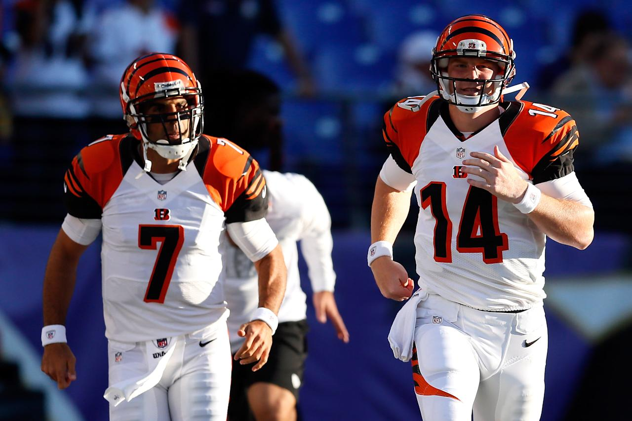 BALTIMORE, MD - SEPTEMBER 10:  Quarterback Bruce Gradkowski #7 and quarterback Andy Dalton #14 of the Cincinnati Bengals run on the field before taking on the Baltimore Ravens at M&T Bank Stadium on September 10, 2012 in Baltimore, Maryland.  (Photo by Rob Carr/Getty Images)