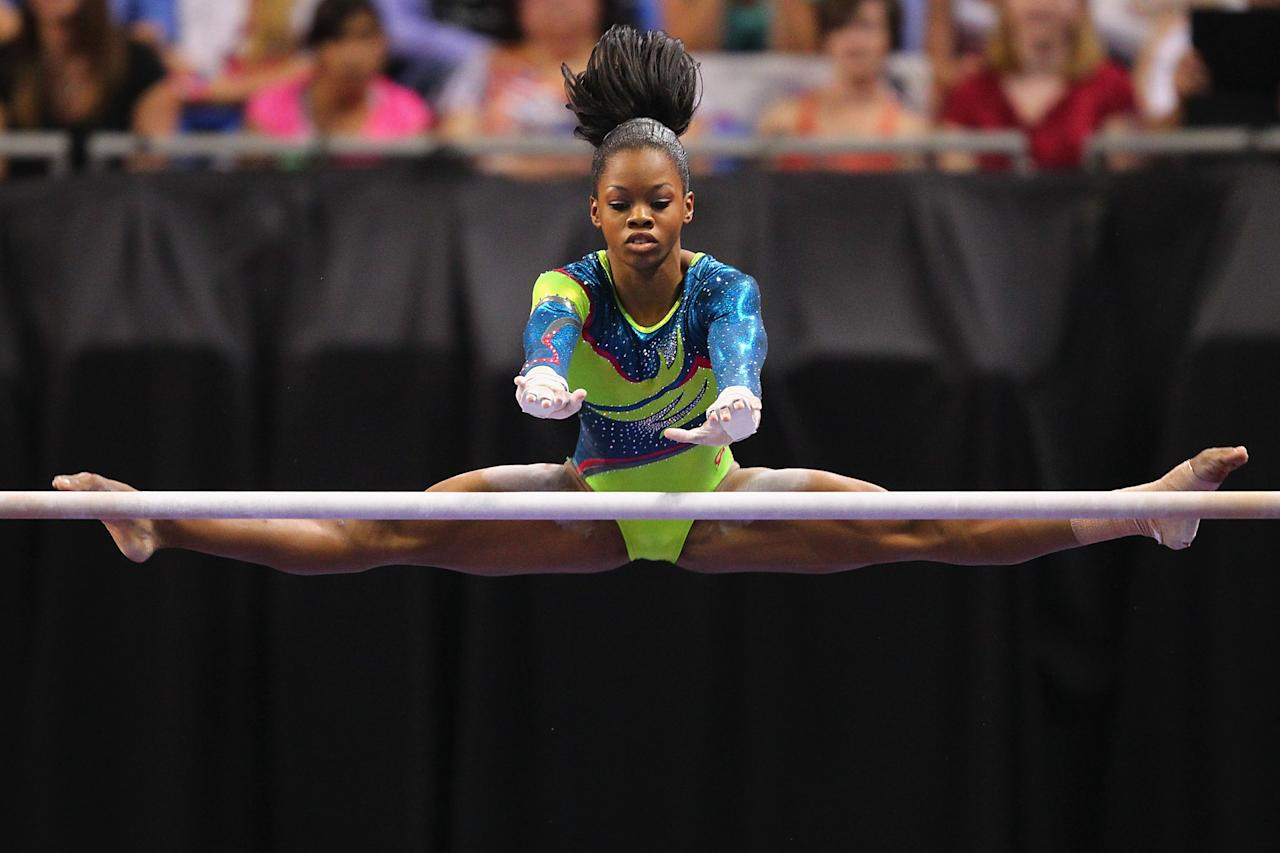 ST. LOUIS, MO - JUNE 10: Gabrielle Douglas competes on the uneven bars during the Senior Women's competition on day four of the Visa Championships at Chaifetz Arena on June 10, 2012 in St. Louis, Missouri.  (Photo by Dilip Vishwanat/Getty Images)
