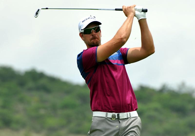 Bjorn rallies with 2 eagles for 65, wins Sun City
