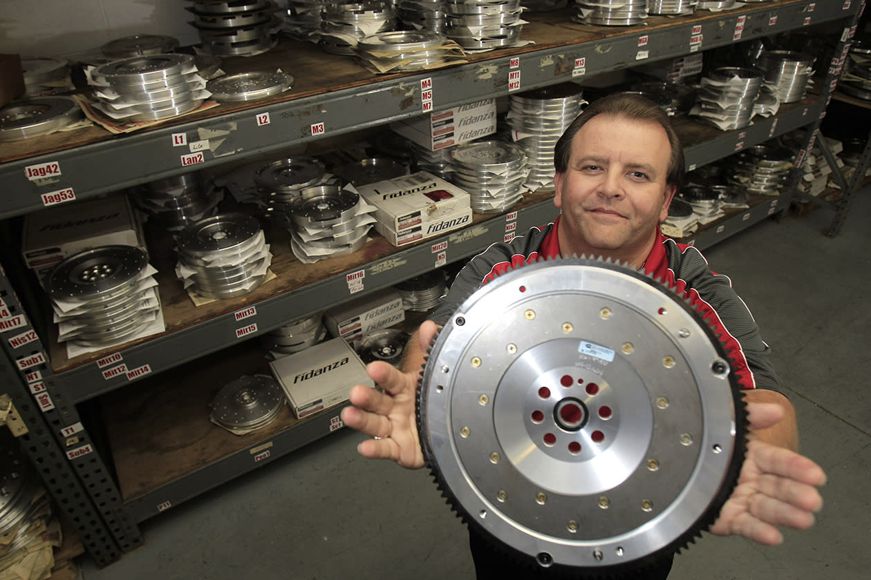 "Ed Burgy, vice president of sales and marketing for Fidanza, holds up a lightweight aluminum flywheel in Perry, Ohio. Burgy, a supporter of President Barack Obama, sees former Massachusetts Gov. Mitt Romney's plan to cut income tax rates across the board, including for the wealthiest households, as a return to trickle-down economics. ""I'm 46 and I've never seen it trickle down to me,"" he says. ""The people who own the companies - they don't trickle it down to the employees. ... Show me the proof and I'll listen to you."""