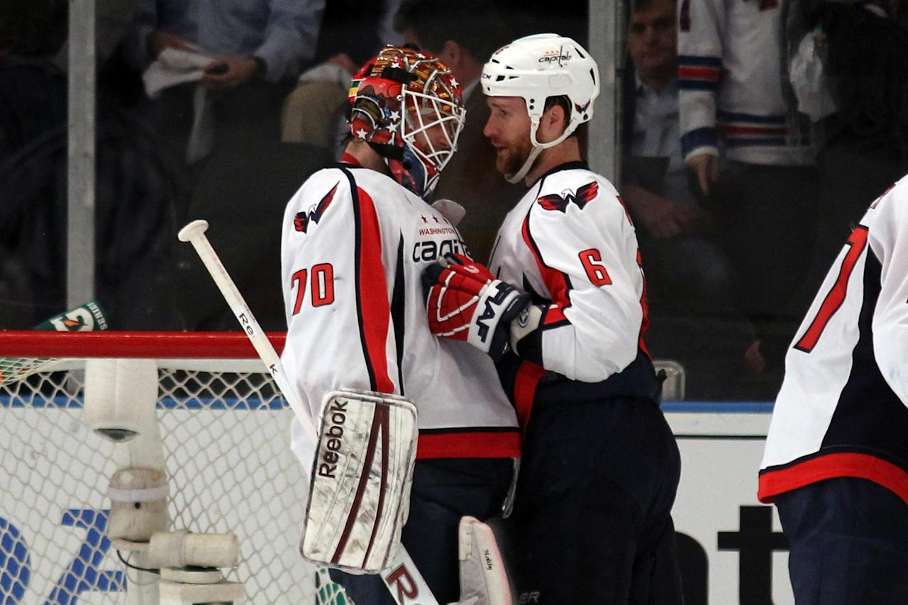 NEW YORK, NY - APRIL 30:  Goalie Braden Holtby #70 and Dennis Wideman #6 of the Washington Capitals celebrate after they won 3-2 against the New York Rangers in Game Two of the Eastern Conference Semifinals during the 2012 NHL Stanley Cup Playoffs at Madison Square Garden on April 30, 2012 in New York City.  (Photo by Bruce Bennett/Getty Images)