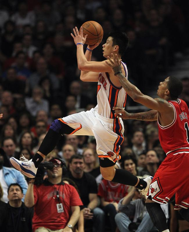CHICAGO, IL - MARCH 12: Jeremy Lin #17 of the New York Knicks drives past Derrick Rose #1 of the Chicago Bulls at the United Center on March 12, 2012 in Chicago, Illinois. The Bulls defeated the Knicks 104-99. NOTE TO USER: User expressly acknowledges and agrees that, by downloading and or using this photograph, User is consenting to the terms and conditions of the Getty Images License Agreement. (Photo by Jonathan Daniel/Getty Images)