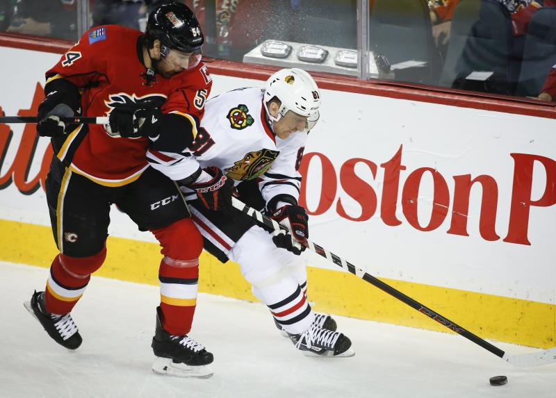 Brodie scores in OT, leads Flames over Blackhawks