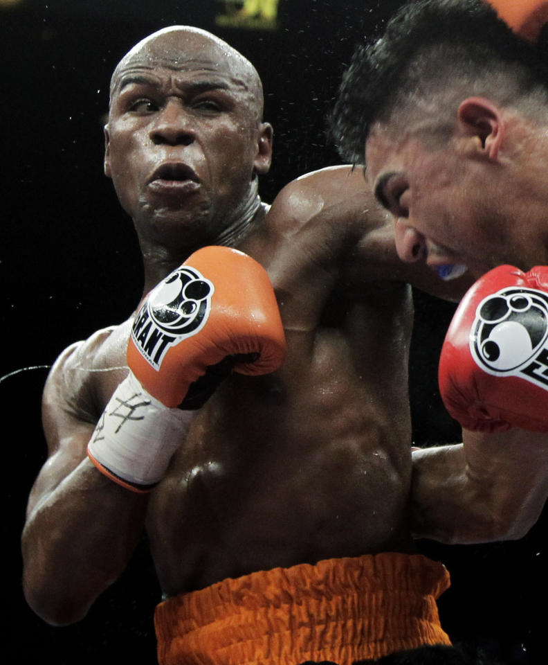 <p>               FILE - This Sept. 17, 2011 file photo shows Floyd Mayweather Jr., left, punching Victor Ortiz during their WBC welterweight title fight in Las Vegas. Lawyers for Mayweather say the undefeated champion boxer may never fight again if he's not released from the Las Vegas jail he entered earlier this month. (AP Photo/Julie Jacobson, File)