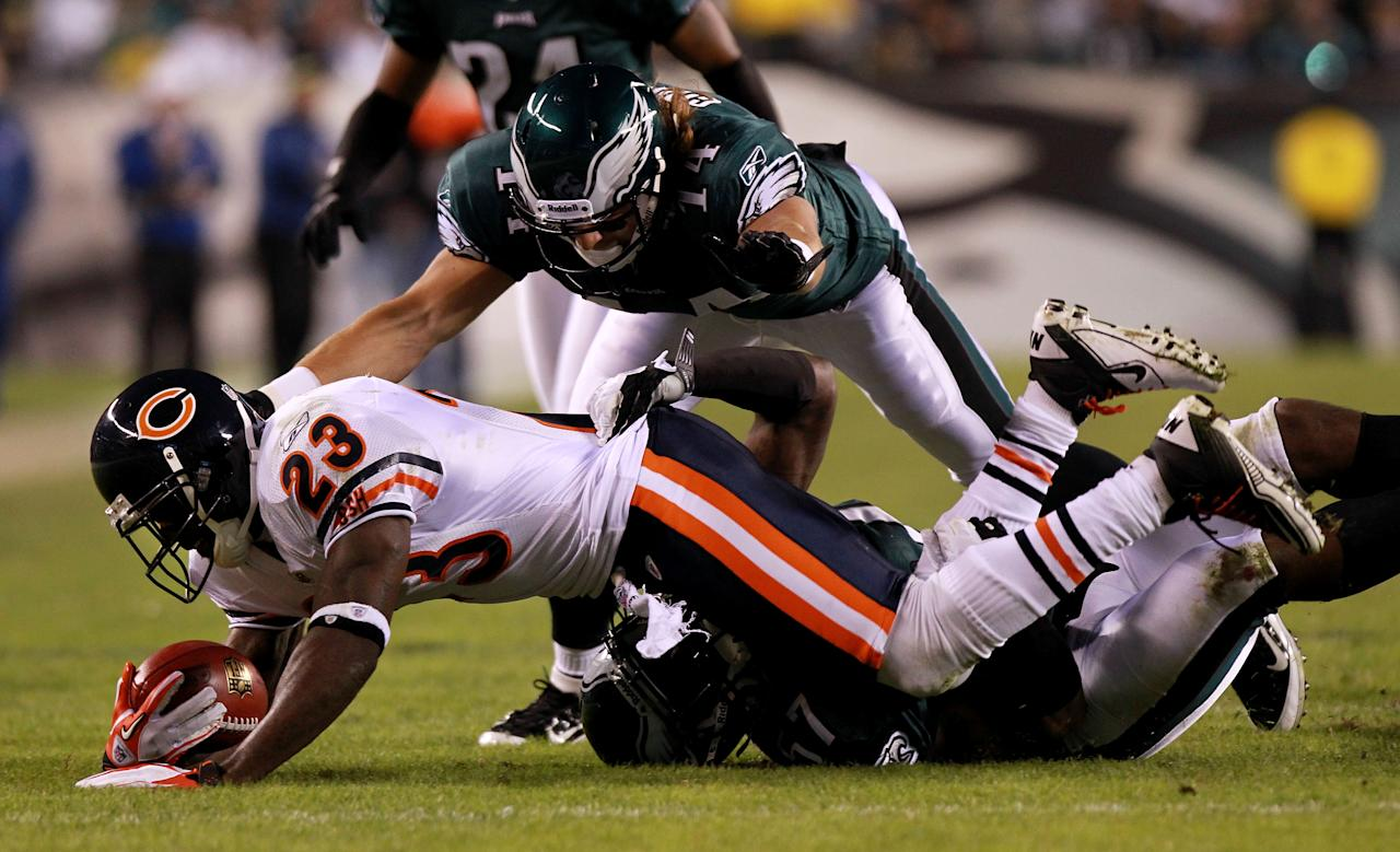 PHILADELPHIA, PA - NOVEMBER 07:  Devin Hester #23 of the Chicago Bears is tackled by Keenan Clayton #57 and  Riley Cooper #14 of the Philadelphia Eagles during the third quarter of the game at Lincoln Financial Field on November 7, 2011 in Philadelphia, Pennsylvania.  (Photo by Nick Laham/Getty Images)