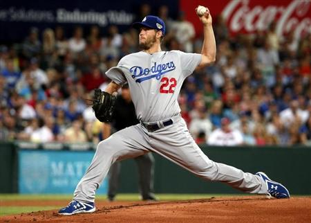 Dodgers pitcher Kershaw delivers a pitch against the Diamondbacks during the opening inning of the opening game the 2014 MLB season at the Sydney Cricket Ground