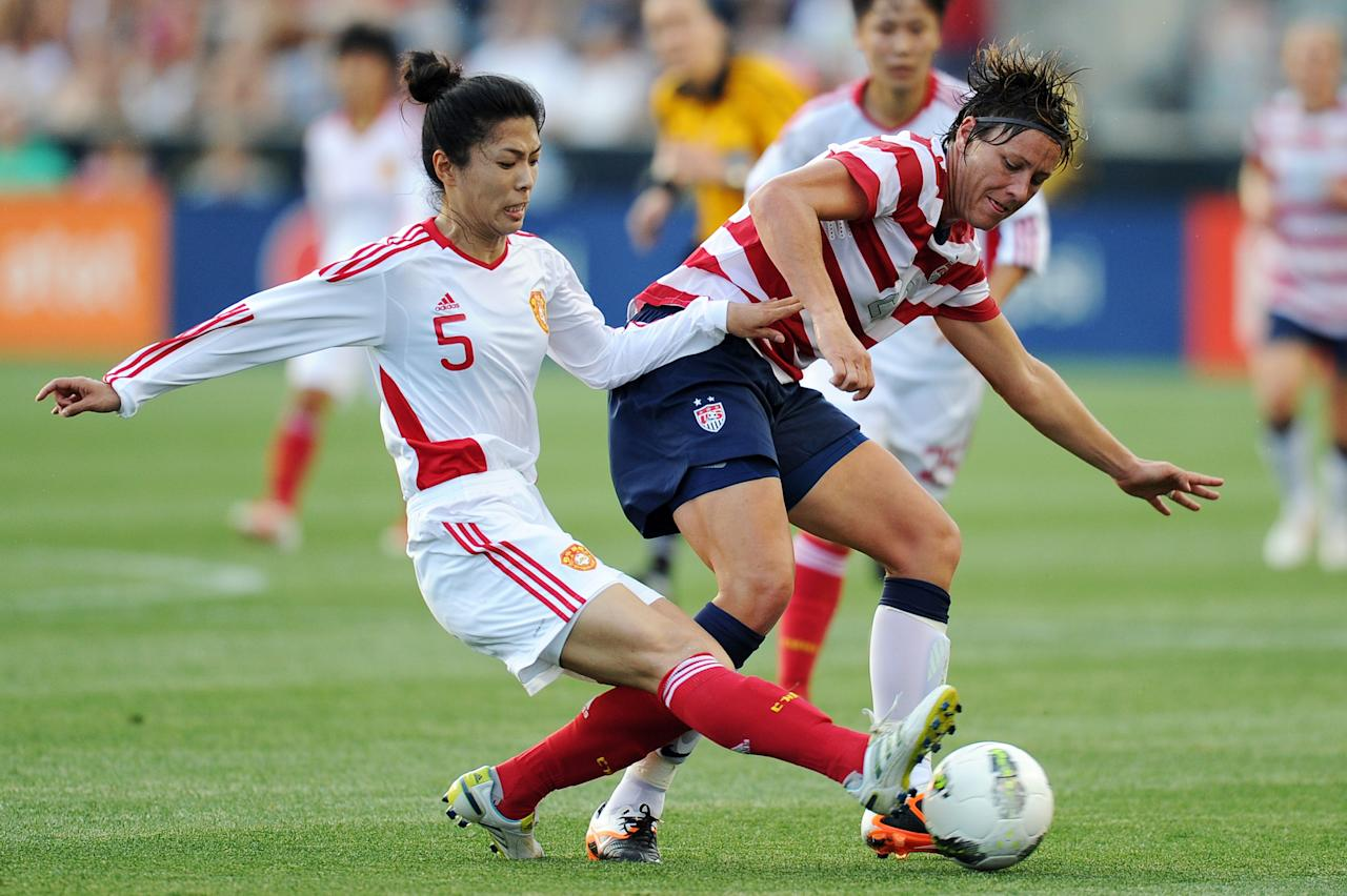 CHESTER, PA - MAY 27: Wang Dongni #5 of China and Abby Wambach #20 of the USA battle for the ball at PPL Park on May 27, 2012 in Chester, Pennsylvania.  (Photo by Drew Hallowell/Getty Images)