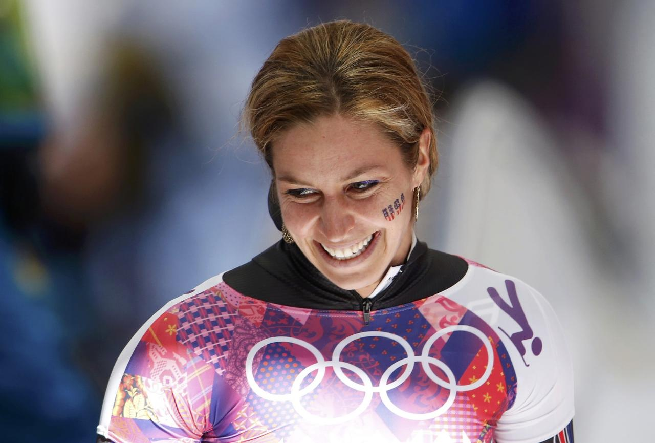 Noelle Pikus-Pace of the U.S. reacts after finishing the women's skeleton event at the 2014 Sochi Winter Olympics at the Sanki Sliding Center in Rosa Khutor February 13, 2014. REUTERS/Fabrizio Bensch (RUSSIA - Tags: OLYMPICS SPORT SKELETON)