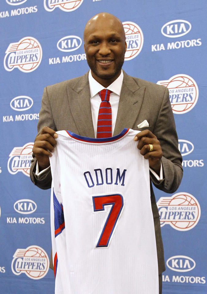 Basketball player Lamar Odom poses with his new jersey at a news conference announcing his acquisition by the Los Angeles Clippers in Los Angeles, California July 2, 2012. REUTERS/Mario Anzuoni  (UNITED STATES - Tags: SPORT BASKETBALL)