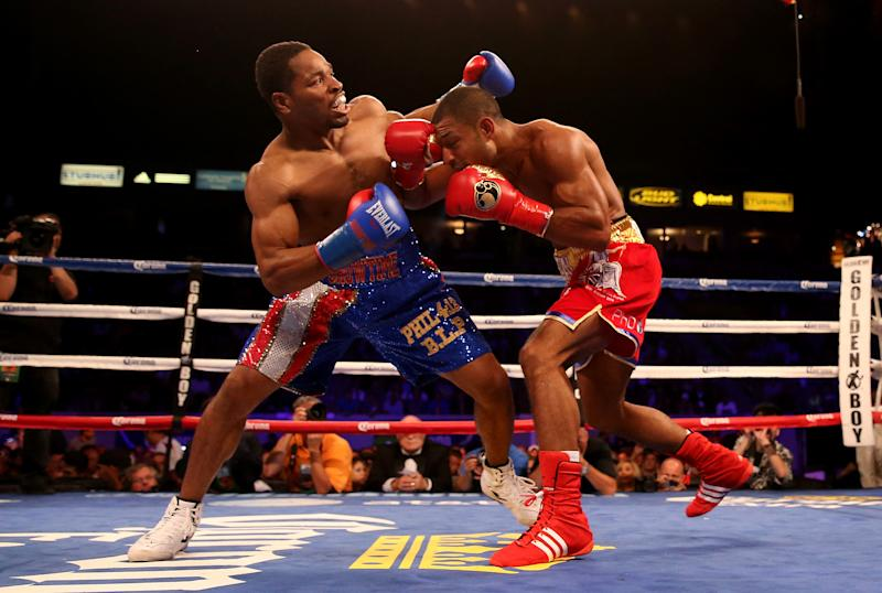 Shawn Porter (L) and Kell Brook battle in their IBF Welterweight World Championship fight at StubHub Center on August 16, 2014 in Los Angeles, California