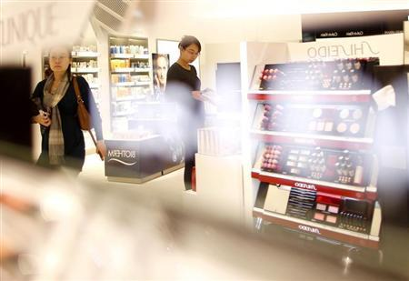 Women look at cosmetic products in a Duty Free store at the Fraport airport in Frankfurt