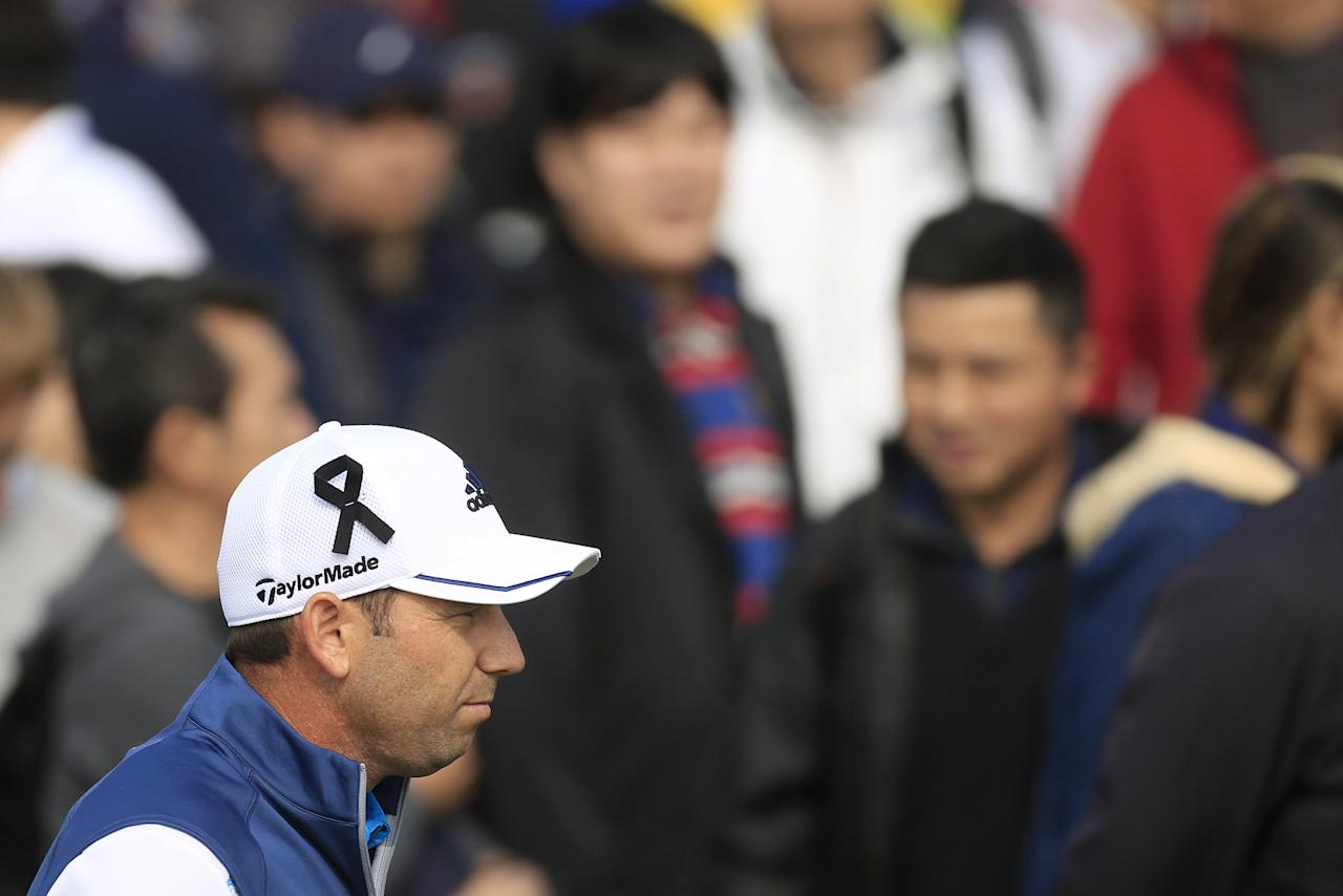 Sergio Garcia of Spain wears a black ribbon on his cap in support of victims of Friday's fatal attacks in Paris, on the eighth hole during the third round of the BMW Masters 2015 golf tournament at Lake Malaren Golf Club in Shanghai, China, November 14, 2015. REUTERS/Aly Song
