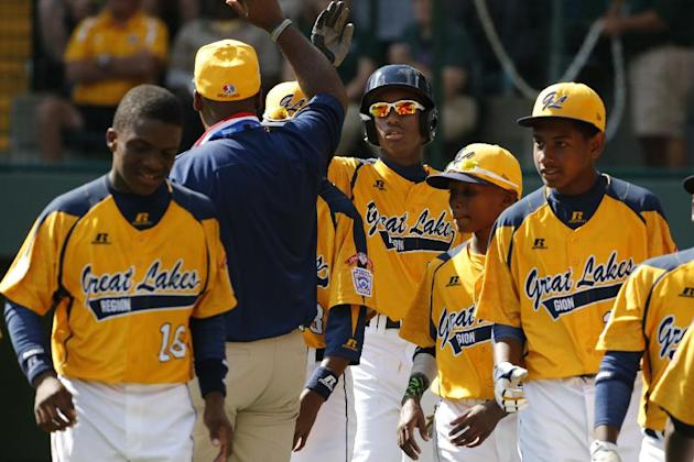The Jackie Robinson West Little League team advanced to the U.S. finals with a win Thursday. (AP)