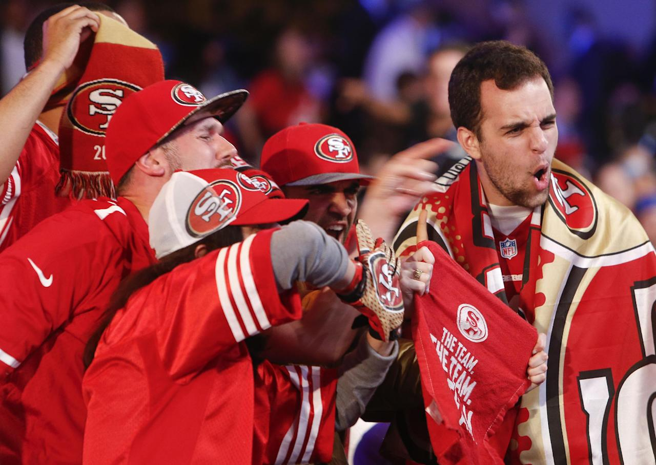 San Francisco 49ers fans cheer during the second round of the 2014 NFL Draft, Friday, May 9, 2014, in New York. (AP Photo/Jason DeCrow)