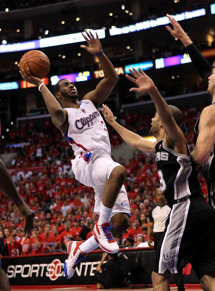 LOS ANGELES, CA - MAY 19:  Chris Paul #3 of the Los Angeles Clippers goes up for a shot against Tony Parker #3 of the San Antonio Spurs in Game Three of the Western Conference Semifinals in the 2012 NBA Playoffs on May 19, 2011 at Staples Center in Los Angeles, California. The Spurs won 96-86 to take a three games to none lead in the series.  NOTE TO USER: User expressly acknowledges and agrees that, by downloading and or using this photograph, User is consenting to the terms and conditions of the Getty Images License Agreement.  (Photo by Stephen Dunn/Getty Images)