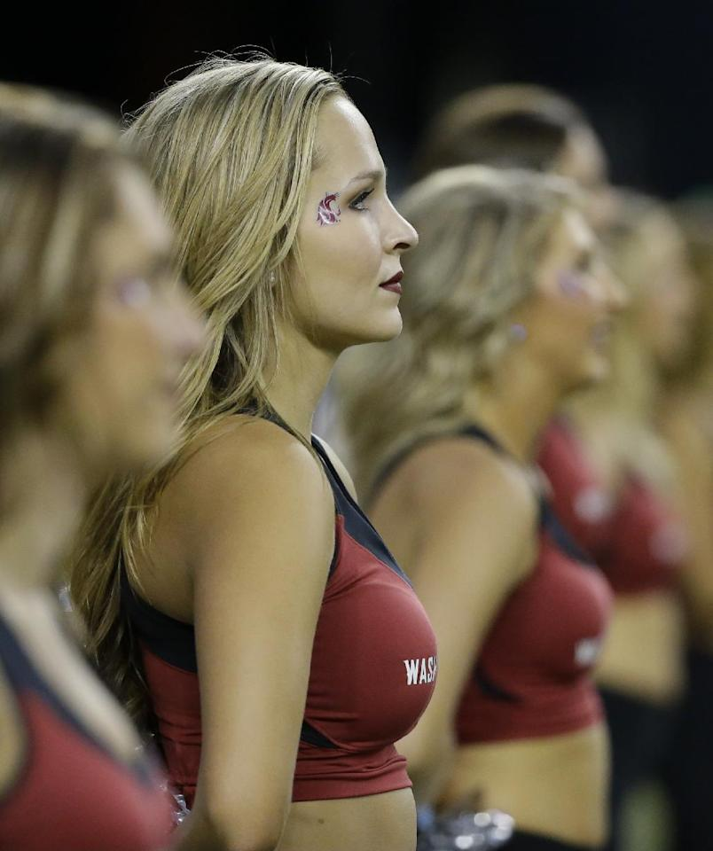Washington State cheerleaders perform during an NCAA college football game against Rutgers, Thursday, Aug. 28, 2014, in Seattle. (AP Photo/Ted S. Warren)