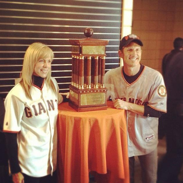 Giants fans pose with National League trophy #worldseries (via @KevinKaduk)