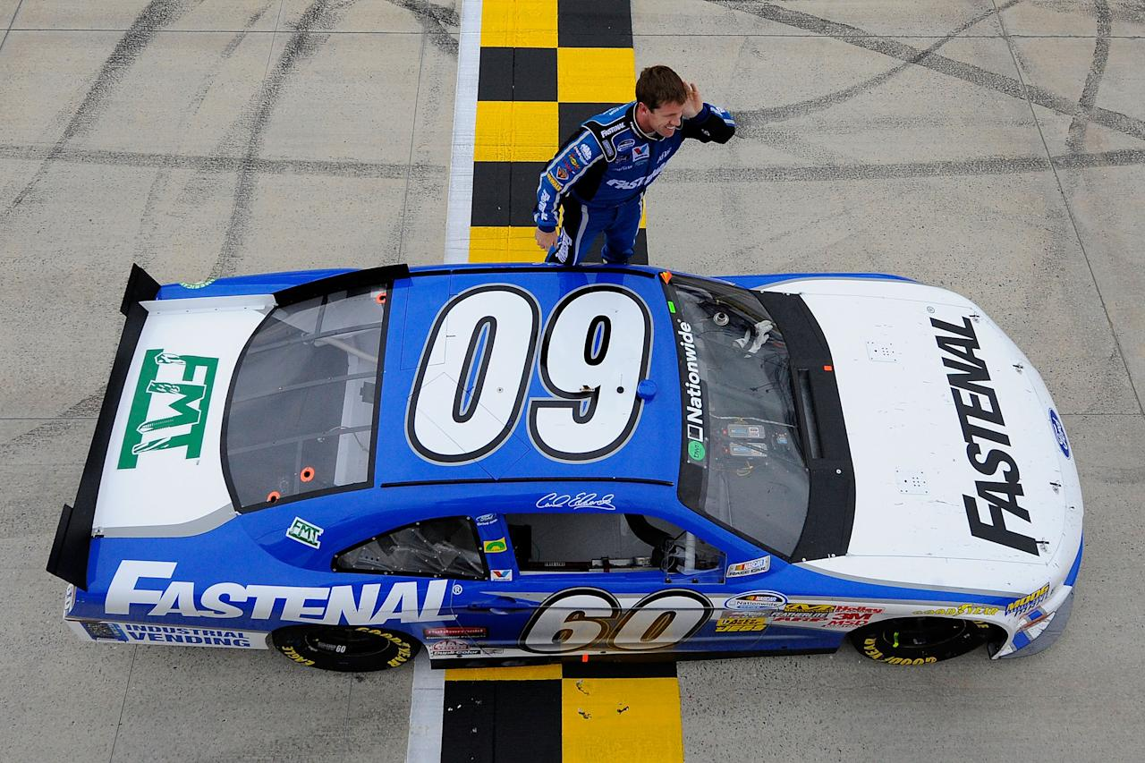 DOVER, DE - OCTOBER 01:  Carl Edwards, driver of the #60 Fastenal Ford, celebrates in front of the fans after he won the NASCAR Nationwide Series OneMain Financial 200 at Dover International Speedway on October 1, 2011 in Dover, Delaware.  (Photo by Jason Smith/Getty Images for NASCAR)