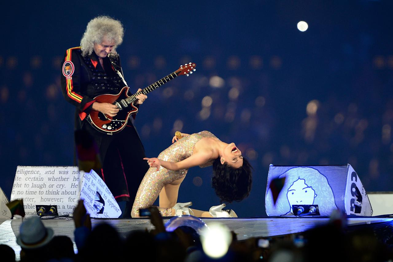 LONDON, ENGLAND - AUGUST 12:  Brian May of Queen performs alongside Jessie J during the Closing Ceremony on Day 16 of the London 2012 Olympic Games at Olympic Stadium on August 12, 2012 in London, England.  (Photo by Pascal Le Segretain/Getty Images)