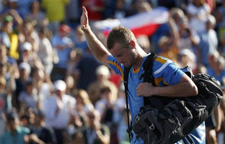 Hewitt of Australia departs after his match against Youzhny of Russia at the U.S. Open tennis championships in New York
