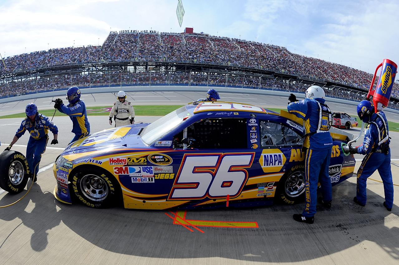 TALLADEGA, AL - OCTOBER 23:  Martin Truex Jr., driver of the #56 NAPA Auto Parts Toyota, makes a pit stop during the NASCAR Sprint Cup Series Good Sam Club 500 at Talladega Superspeedway on October 23, 2011 in Talladega, Alabama.  (Photo by Jason Smith/Getty Images)