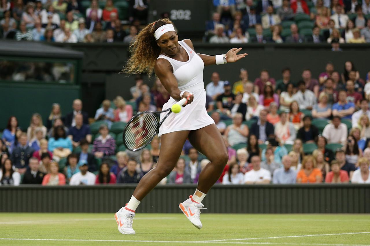 LONDON, ENGLAND - JUNE 29: Serena Williams of the United States of America plays a forehand during the Ladies' Singles third round match against Kimiko Date-Krumm of Japan on day six of the Wimbledon Lawn Tennis Championships at the All England Lawn Tennis and Croquet Club on June 29, 2013 in London, England. (Photo by Clive Brunskill/Getty Images)
