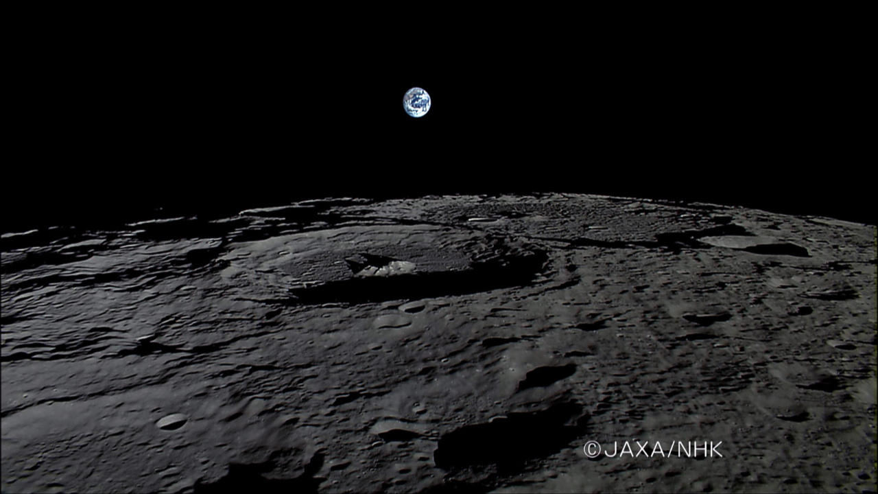 The Earth rises over the Moon's surface in this still from a HDTV video camera onboard Japan's KAGUYA lunar probe at 0552 GMT November 7, 2007 and released November 14, 2007. In the image the Earth's North Pole is oriented up.  REUTERS/Japan Aerospace Exploration Agency/Handout.