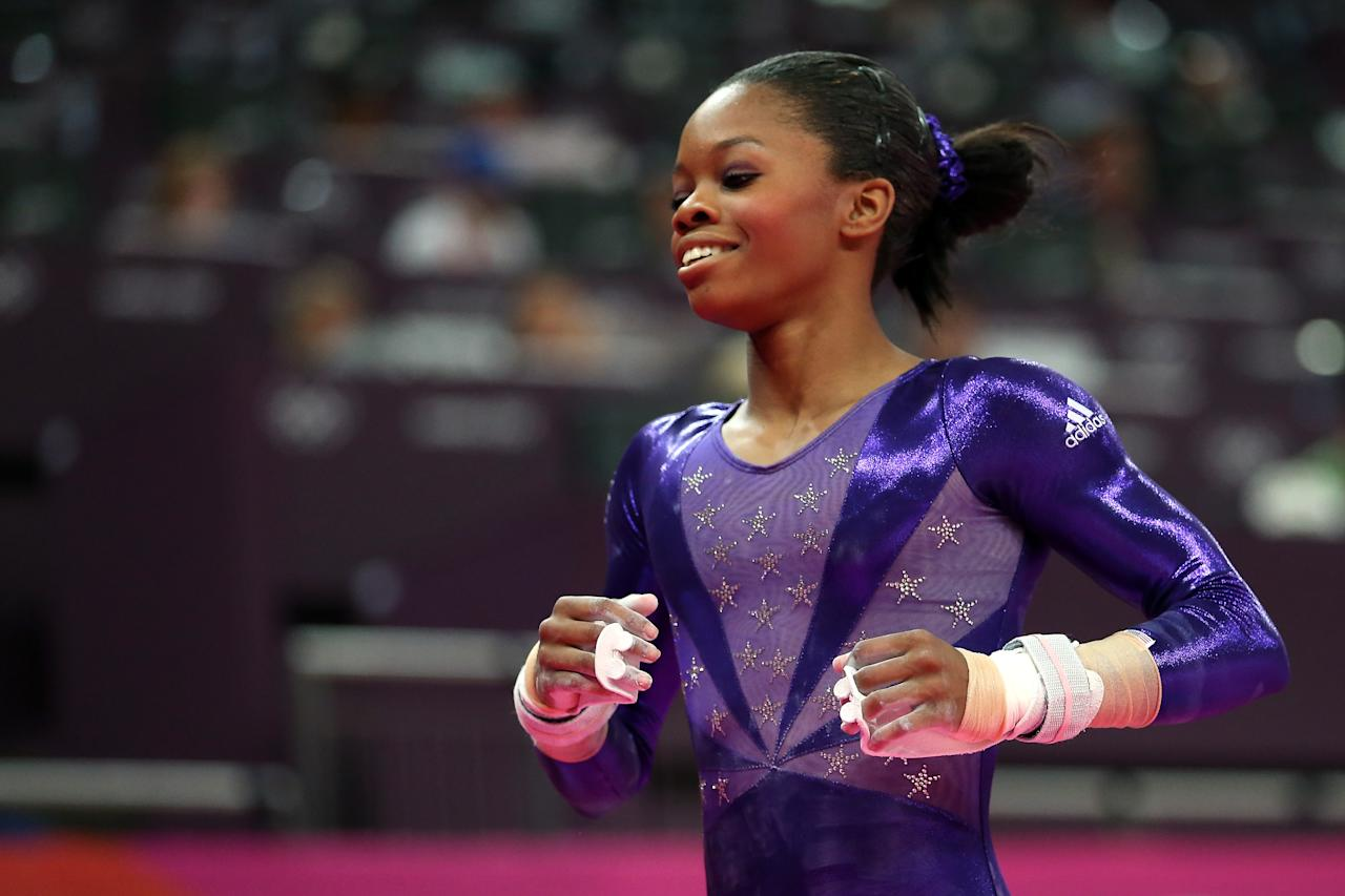 LONDON, ENGLAND - JULY 29:  Gabrielle Douglas of the United States smiles after she competes in the uneven bars in the Artistic Gymnastics Women's Team qualification on Day 2 of the London 2012 Olympic Games at North Greenwich Arena on July 29, 2012 in London, England.  (Photo by Ronald Martinez/Getty Images)