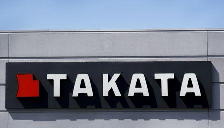 Takata sells auto interiors unit as recall costs rise