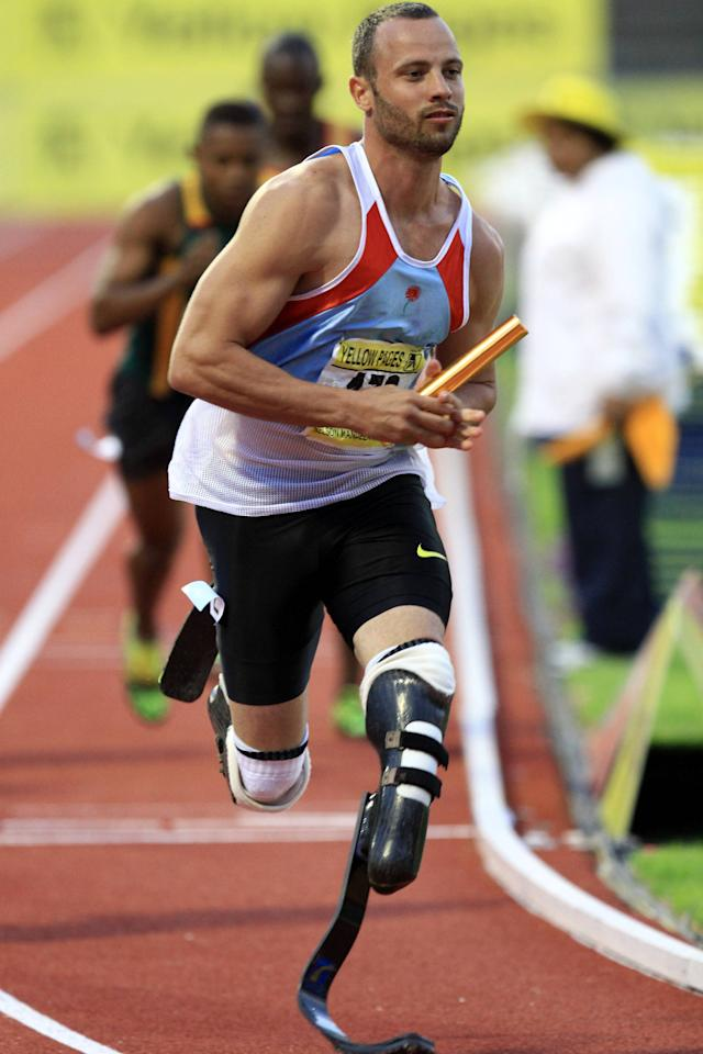 PORT ELIZABETH, SOUTH AFRICA - APRIL 14:  Oscar Pistorius runs with the relay baton during day 2 of the Yellow Pages South African Senior Championship at Nelson Mandela Metropolitan University on April 14, 2012 in Port Elizabeth, South Africa.  (Photo by Richard Huggard/Gallo Images/Getty Images)