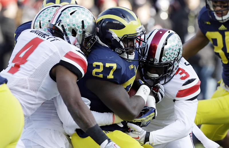 No. 3 Ohio State holds on to beat Michigan 42-41