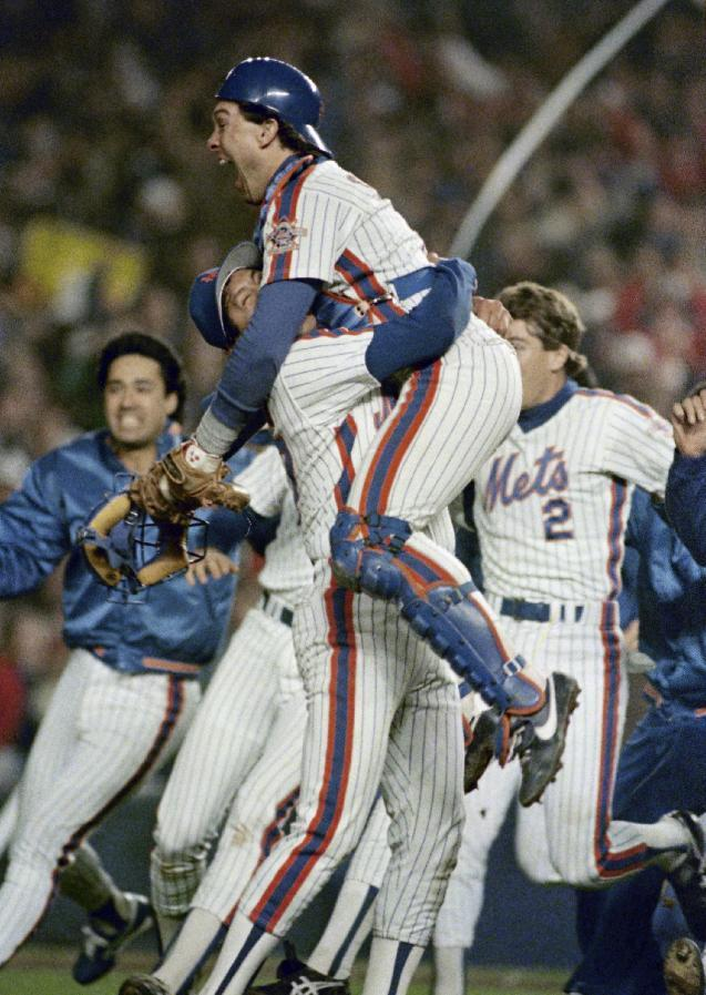 FILE - In this Oct. 27, 1986, file photo, New York Mets Gary Carter is lifted in the air by relief pitcher Jese Orosco following the Met 8-5 victory over the Boston Red Sox in Game 7 of baseballs World Series at New York's Shea Stadium. Baseball Hall of Fame president Jeff Idelson said Thursday, Feb. 16, 2012, that Hall of Fame catcher Gary Carter has died. (AP Photo/Paul Benoit, File)