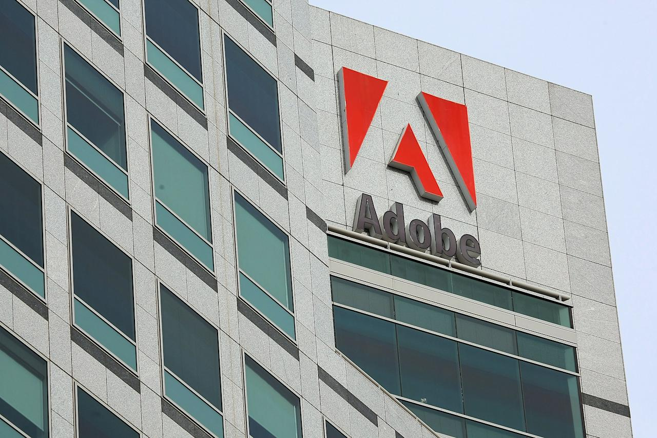 SAN JOSE, CA - JANUARY 15: The Adobe logo is displayed on the side of the Adobe Systems headquarters January 15, 2010 in San Jose, California. Adobe Systems has added 20 new wind turbines to their rooftops in an attempt to harness wind energy to help power their offices. Each 30 foot tall aluminum wind turbine is capable of capturing a maximum of 1.2 kilowatts of electricty.   Justin Sullivan/Getty Images/AFP