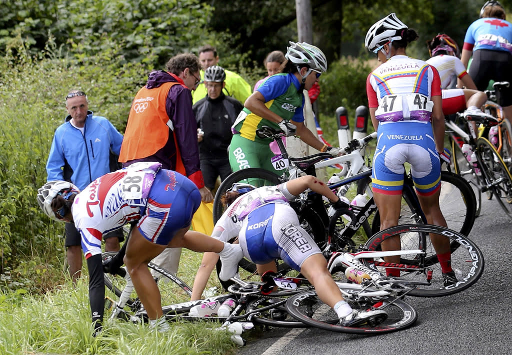 Taiwan's Hsiao Mei Yu (58), South Korea's Na Ah-reum (54), Brazil's Fernanda da Silva Souza (40) and Venezuela's Danielys Garcia (47) try to recover from a crash during the Women's Road Race Road Cycling Day 2 of the London 2012 Olympic Games on July 29, 2012 in London, England. (Photo by Stefano Rellandini - IOPP Pool Getty Images)