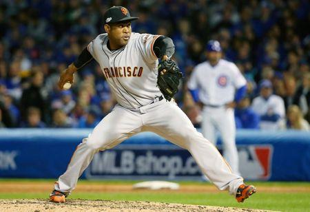 Oct 8, 2016; Chicago, IL, USA; San Francisco Giants relief pitcher Santiago Casilla (46) pitches against the Chicago Cubs during the sixth inning during game two of the 2016 NLDS playoff baseball series at Wrigley Field. Mandatory Credit: Jerry Lai-USA TODAY Sports