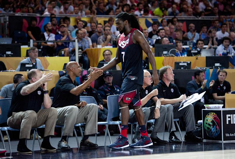 United States's Kenneth Faried, shakes hands with staff member during the Group C Basketball World Cup match against Turkey, in Bilbao, northern Spain, Sunday, Aug. 31, 2014