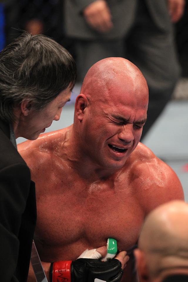 Tito Ortiz exhibits the pain of a blow to the ribs after his TKO loss to Antonio Rogerio Nogueira during the UFC 140 event at Air Canada Centre on December 10, 2011 in Toronto, Ontario, Canada. (Photo by Nick Laham/Zuffa LLC/Zuffa LLC via Getty Images)