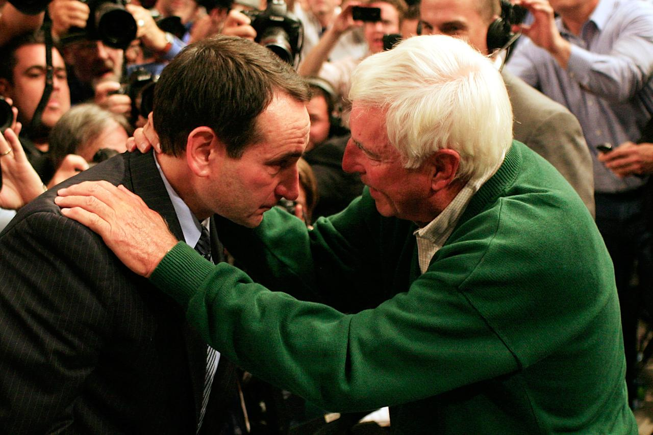 NEW YORK, NY - NOVEMBER 15:  Head coach Mike Krzyzewski of the Duke Blue Devils hugs Bob Knight after winning his 903rd game and passing him to become the all-time winningest coach in Men's Division 1 Basketball during the 2011 State Farm Champions Classic at Madison Square Garden on November 15, 2011 in New York City.  (Photo by Patrick McDermott/Getty Images)