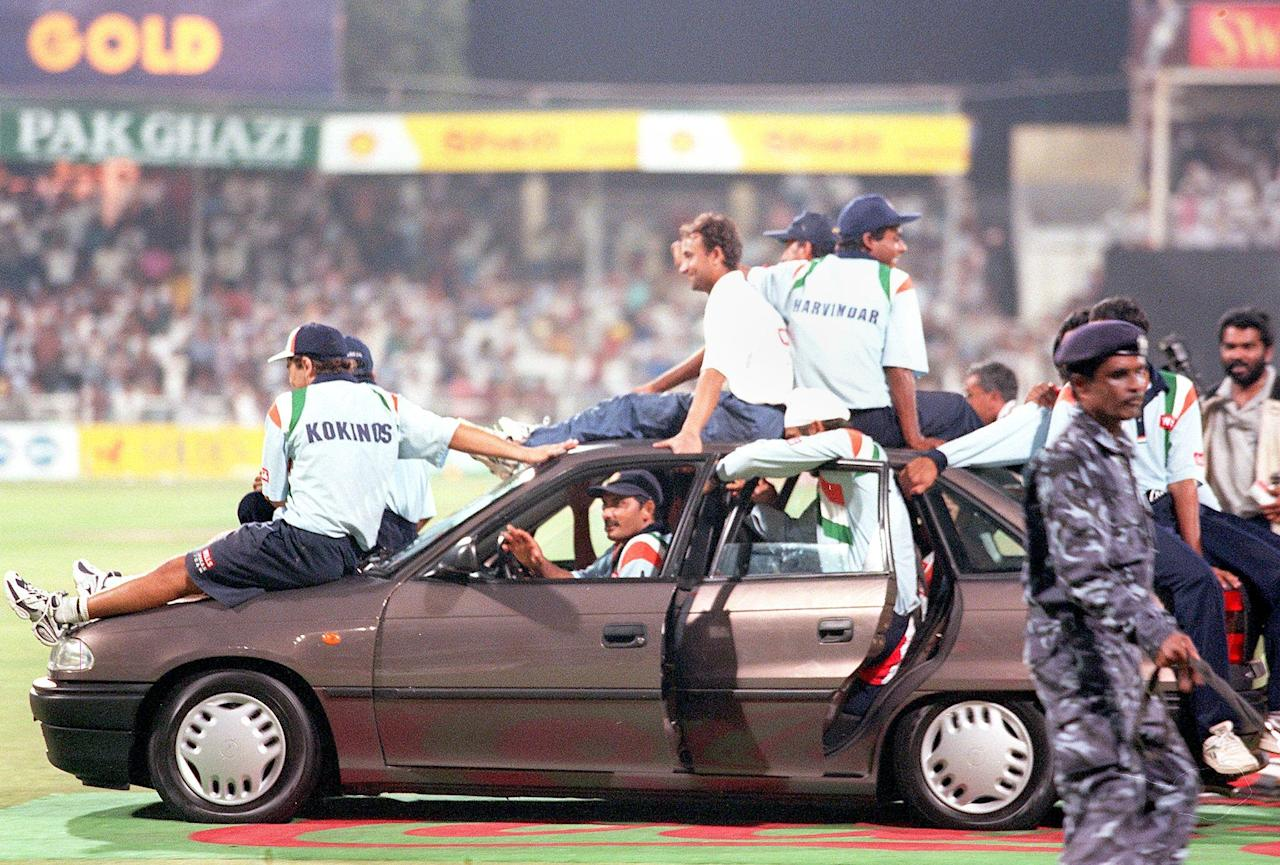 Indian cricket captain Mohamed Azharuddine drives a car his team was presented after defeating Australia in the Sharjah Cup final 25 April.