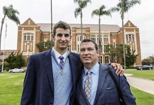 Austin Hatch poses for a photo with his uncle, Michael Hatch. (AP)