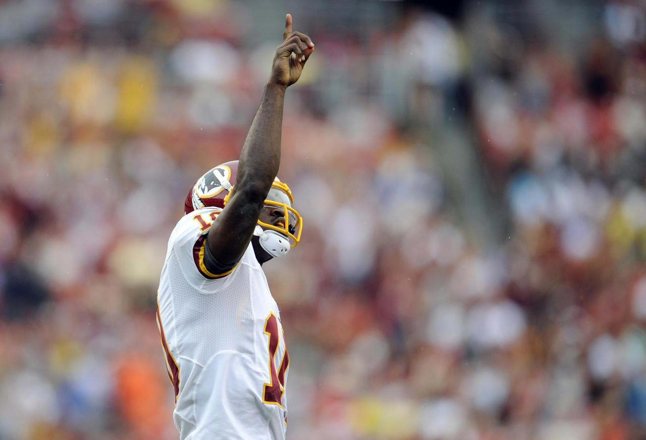 Washington Redskins quarterback Robert Griffin III celebrates after a Redskins touchdown during the first half of an NFL preseason football game against the Indianapolis Colts on Saturday, Aug. 25, 2012, in Landover, Md. (AP Photo/Nick Wass)